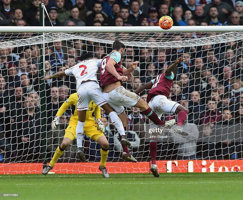 Andy Carroll of West Ham United scores the second goal during the Barclays Premier League match between West Ham United and Liverpool at Boleyn Ground on January 2, 2016 in London, England.