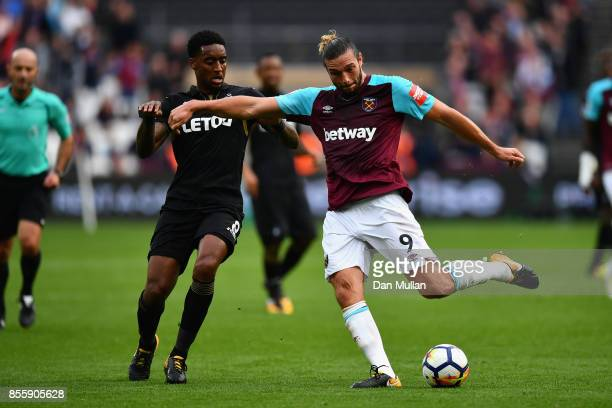 Andy Carroll of West Ham United shoots at goal during the Premier League match between West Ham United and Swansea City at London Stadium on...