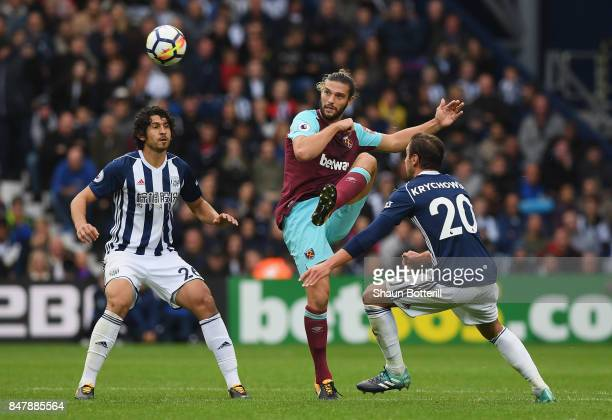 Andy Carroll of West Ham United shoots during the Premier League match between West Bromwich Albion and West Ham United at The Hawthorns on September...