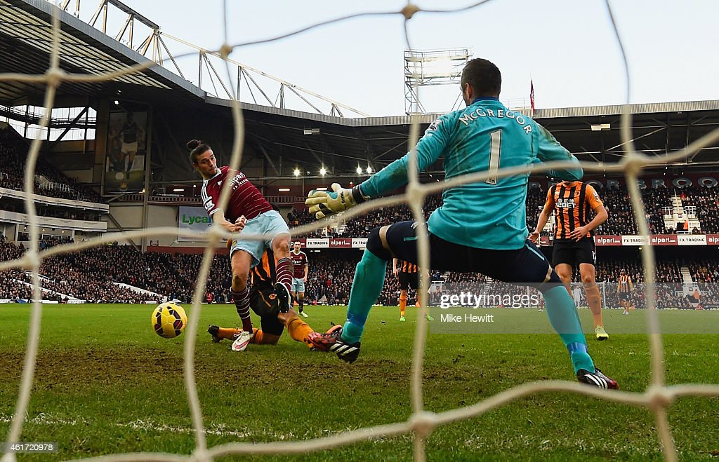 Andy Carroll of West Ham United shoots past goalkeeper Allan McGregor of Hull City to score their first goal during the Barclays Premier League match between West Ham United and Hull City at Boleyn Ground on January 18, 2015 in London, England.