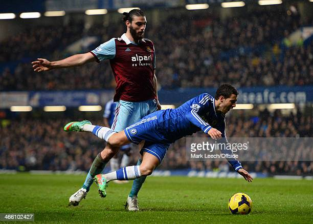 Andy Carroll of West Ham United trips Eden Hazard of Chelsea during the Barclays Premier League match between Chelsea and West Ham United at Stamford...