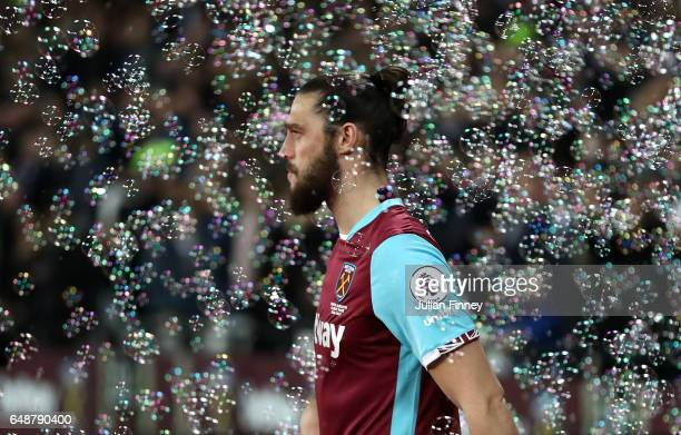 Andy Carroll of West Ham United walks out onto the pitch during the Premier League match between West Ham United and Chelsea at London Stadium on...