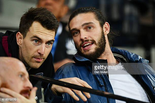 Andy Carroll of West Ham Unitwins a header watches the game from the crowd during the EFL Cup fourth round match between West Ham United and Chelsea...