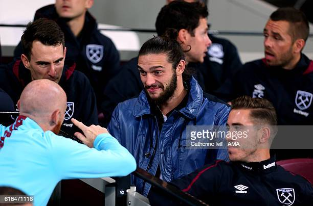 Andy Carroll of West Ham watches from the stands during the EFL Cup fourth round match between West Ham and Chelsea at The London Stadium on October...