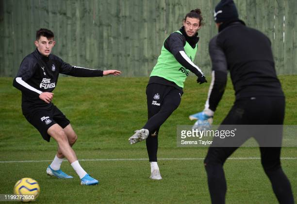 Andy Carroll passes the ball as Kelland Watts defends the pass during the Newcastle United Training Session at the Newcastle United Training Centre...