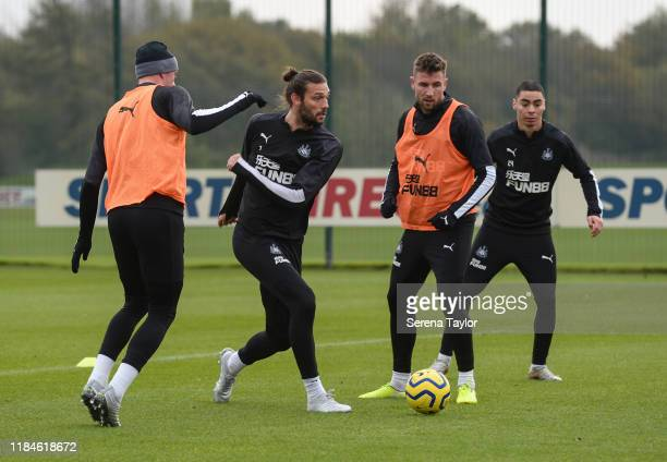 Andy Carroll passes the ball as Sean Longstaff and Paul Dummett apply pressure (also seen is Miguel Almiron during the Newcastle United Training...
