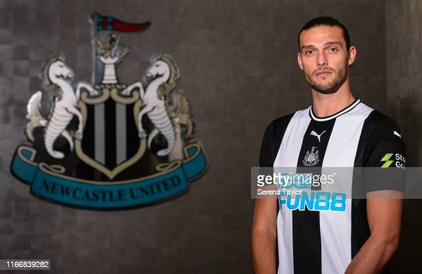 Andy Carroll poses for photographs with the club crest at St.James' Park during a photocall on August 08, 2019 in Newcastle upon Tyne, England.