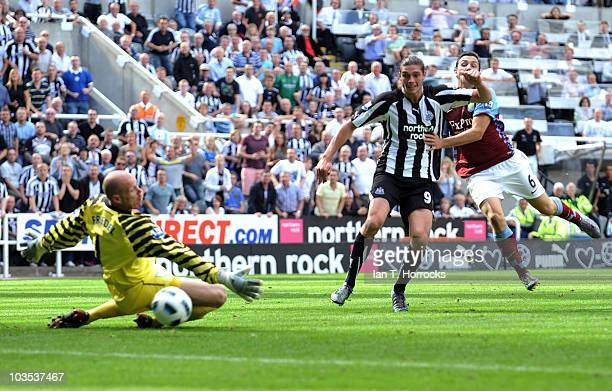 Andy Carroll scores the sixth goal for Newcastle giving him a hat-trick during the Barclays Premier League match between Newcastle United and Aston...