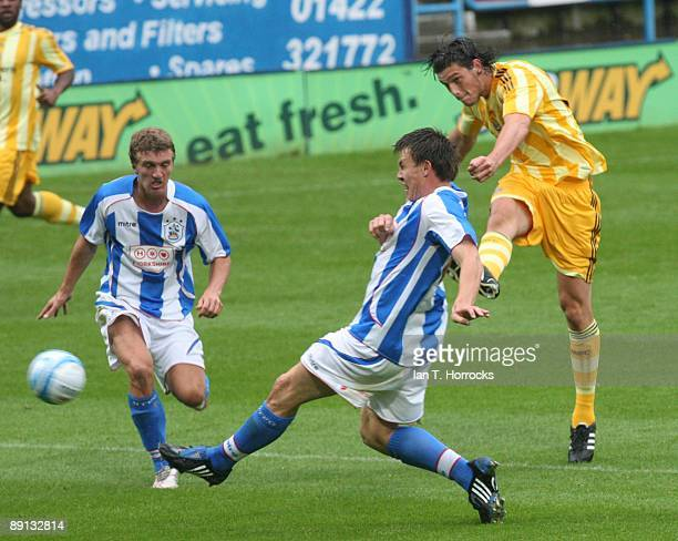 Andy Carroll shoots during a preseason friendly match between Huddersfield Town and Newcastle United at the Galpharm Stadium on July 21 2009 in...