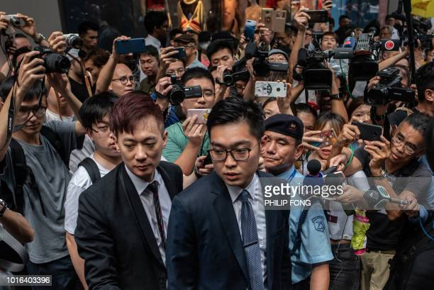 Andy Chan founder of the Hong Kong National Party is surrounded by members of the media as he leaves the Foreign Correspondents' Club in Hong Kong on...