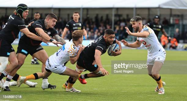 Andy Christie of Saracens is tackled during the Gallagher Premiership Rugby match between Saracens and Wasps at StoneX Stadium on October 24, 2021 in...