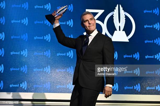 Andy Cohen celebrates on stage wth an award during the 30th Annual GLAAD Media Awards in partnership with Ketel One FamilyMade Vodka longstanding...