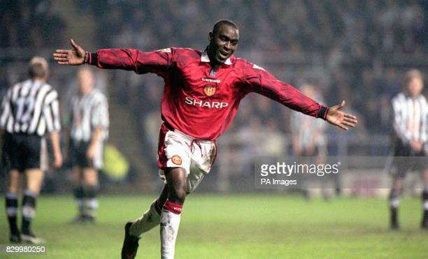 Andy Cole celebrates while Newcastle stand shocked after their former player sent them reeling to a one goal to nil defeat by Manchester United in...