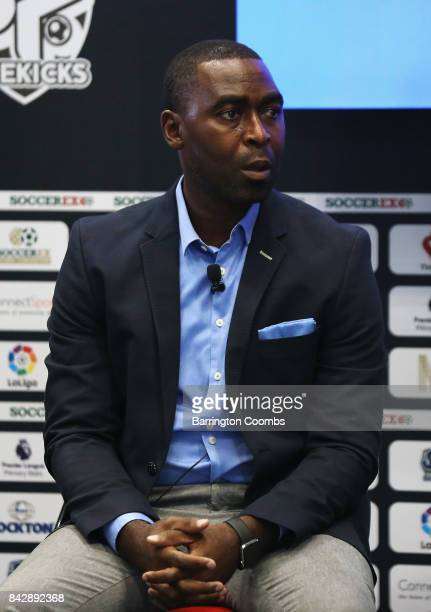 Andy Cole looks on in the Love Football Zone during day 2 of the Soccerex Global Convention at Manchester Central Convention Complex on September 5...