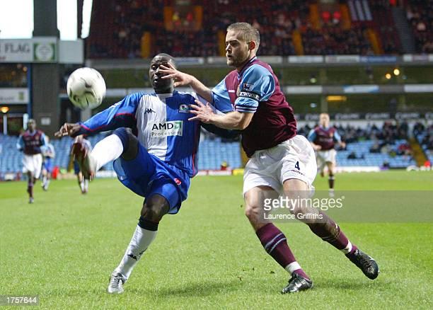Andy Cole of Blackburn Rovers battles with Olof Mellberg of Aston Villa during the FA Barclaycard Premiership match between Aston Villa and Blackburn...