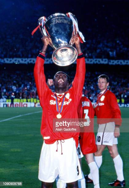 Andy Cole of Manchester United celebrate the victory with the trophy during the UEFA Champions league final match between Manchester United and...