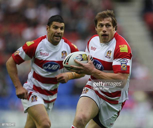 Andy Coley of Wigan Warriors is supported by Trent Barrett during the engage super league match between Wigan Warriors and Harlequins at the JJB...