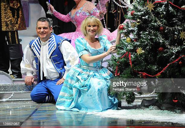 Andy Collins and Joana Page attend First Family Entertainment theatre company's annual group Pantomime photocall at Piccadilly Theatre on November 26...