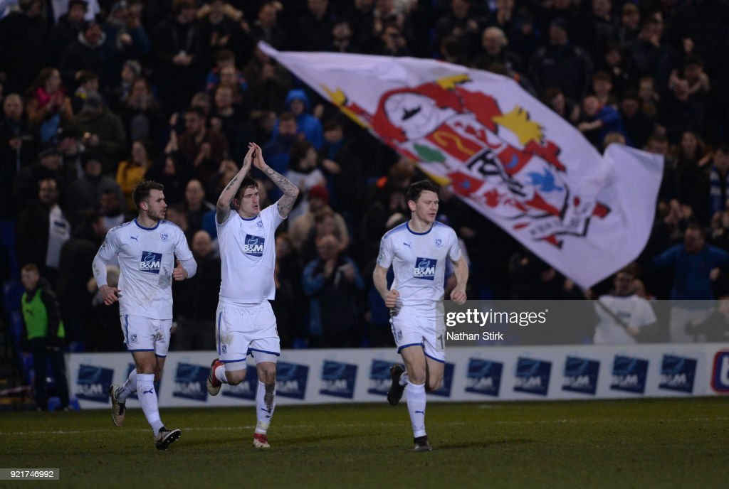 Andy Cook of Tranmere Rovers claps his team mates after he scores during the Vanarama National League match between Tranmere Rovers and Macclesfield Town at Prenton Park on February 20, 2018 in Birkenhead, England.