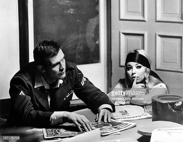 Andy Crocker sits at a table with Karen in a scene from the movie Ballad Of Andy Crocker which was released on November 18 1969