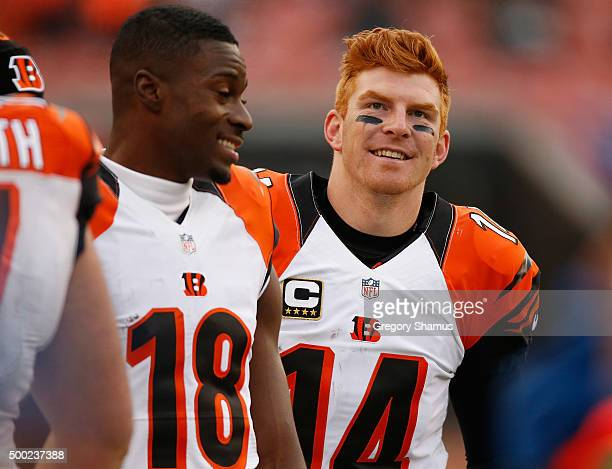Andy Dalton and AJ Green of the Cincinnati Bengals smile on the sideline late in the fourth quarter while playing the Cleveland Browns at FirstEnergy...