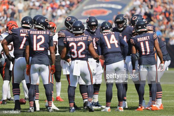 Andy Dalton of the Chicago Bears calls the play in the huddle against the Cincinnati Bengals at Soldier Field on September 19, 2021 in Chicago,...