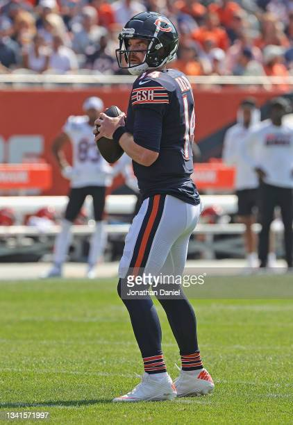 Andy Dalton of the Chicago Bears looks for a receiver against the Cincinnati Bengals at Soldier Field on September 19, 2021 in Chicago, Illinois. The...
