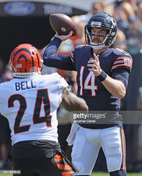 Andy Dalton of the Chicago Bears passes under pressure from Vonn Bell of the Cincinnati Bengals at Soldier Field on September 19, 2021 in Chicago,...