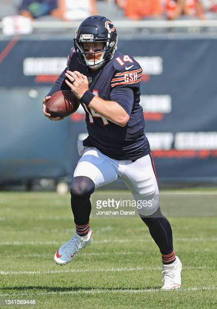 Andy Dalton of the Chicago Bears runs against the Cincinnati Benals at Soldier Field on September 19, 2021 in Chicago, Illinois. The Bears defeated...
