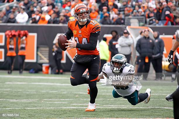 Andy Dalton of the Cincinnati Bengals avoids an attempted tackle by Marcus Smith II of the Philadelphia Eagles during the first quarter at Paul Brown...