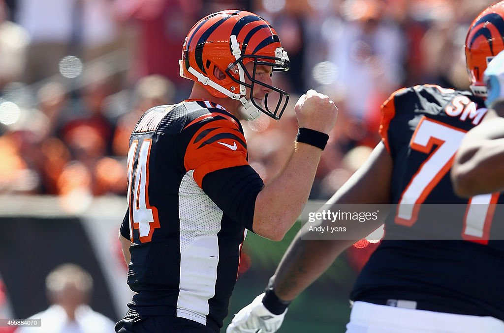 Andy Dalton #14 of the Cincinnati Bengals celebrates a touchdown during the game against the Tennessee Titans at Paul Brown Stadium on September 21, 2014 in Cincinnati, Ohio.
