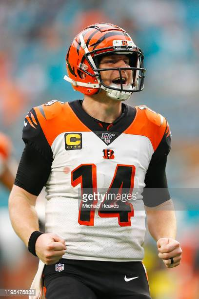 Andy Dalton of the Cincinnati Bengals celebrates after throwing a touchdown as time expired against the Miami Dolphins during the fourth quarter at...