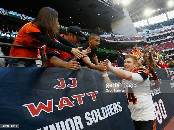 Andy Dalton of the Cincinnati Bengals celebrates with fans in the stands after the Bengals defeated the Houston Texans 2213 at NRG Stadium on...