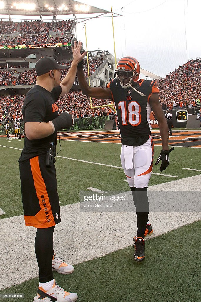 Andy Dalton #14 of the Cincinnati Bengals congratulates A.J. Green #18 of the Cincinnati Bengals after scoring a touchdown during the second quarter of the game against the Pittsburgh Steelers at Paul Brown Stadium on December 13, 2015 in Cincinnati, Ohio.