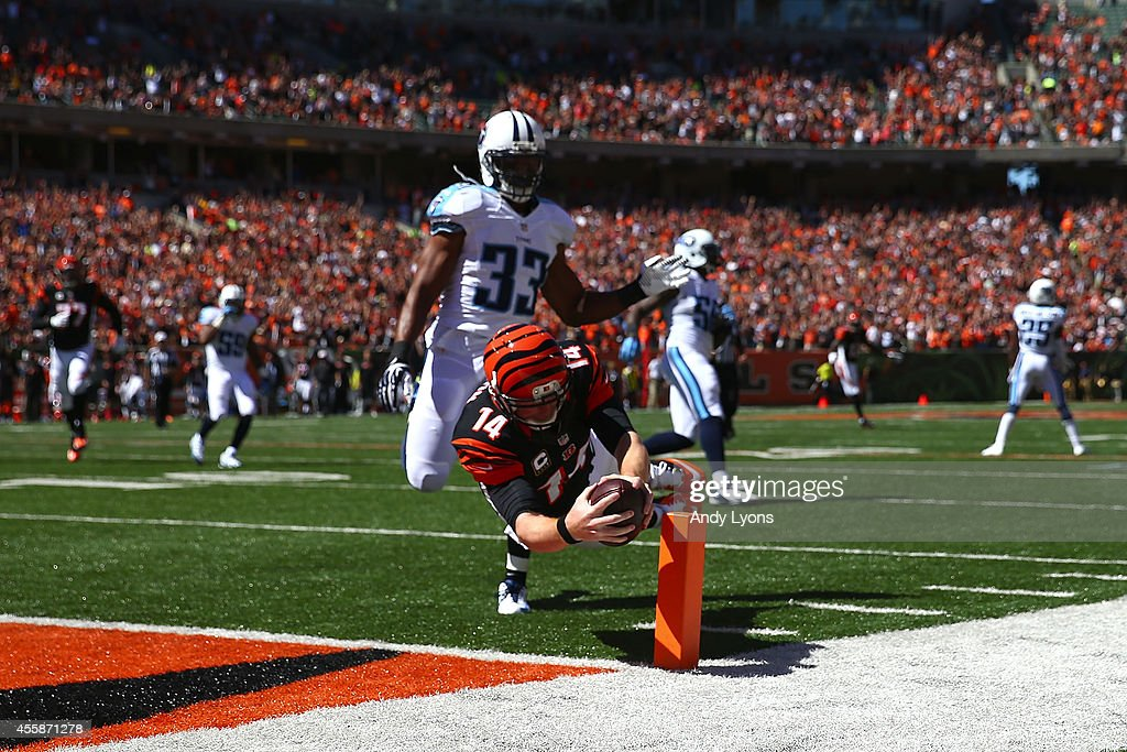 Andy Dalton #14 of the Cincinnati Bengals dives into the end zone to score a touchdown during the first quarter against the Tennessee Titans at Paul Brown Stadium on September 21, 2014 in Cincinnati, Ohio.