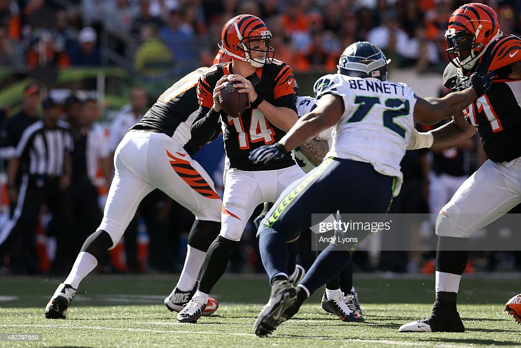 Andy Dalton #14 of the Cincinnati Bengals drops back to throw a pass during the fourth quarter of the game against the Seattle Seahawks at Paul Brown Stadium on October 11, 2015 in Cincinnati, Ohio. Cincinnati defeated Seattle 27-24 in overtime.