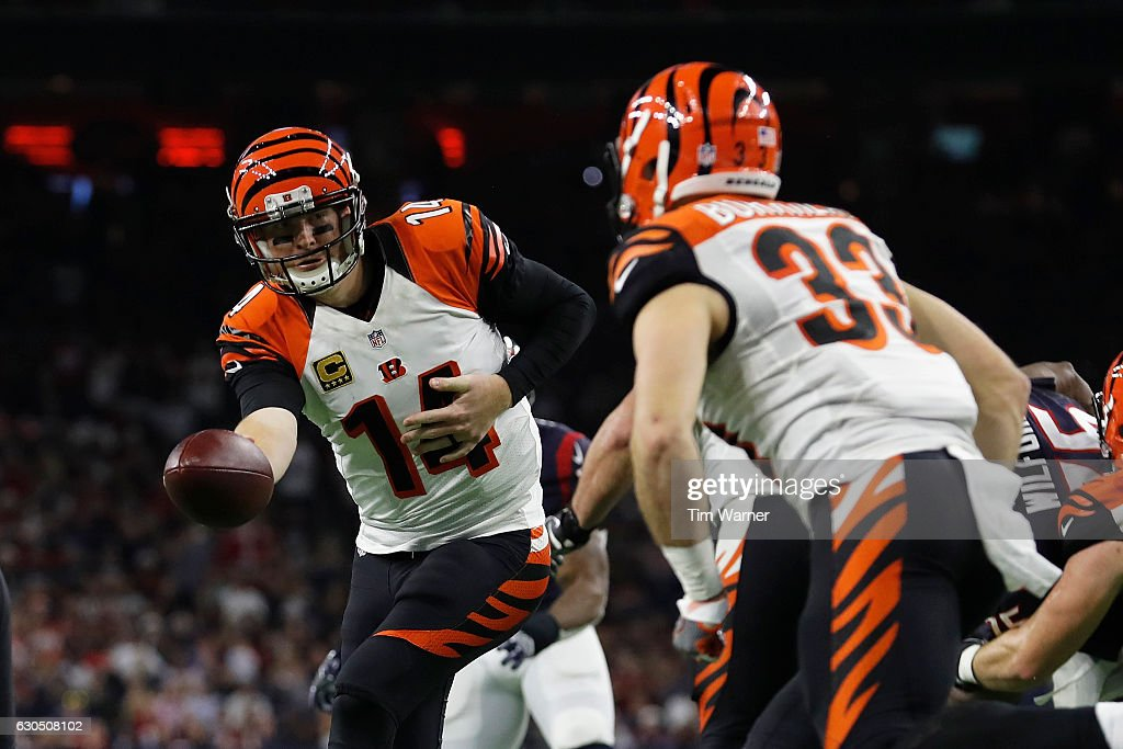 Andy Dalton #14 of the Cincinnati Bengals hands the ball to Rex Burkhead #33 of the Cincinnati Bengals in the fourth quarter against the Houston Texans at NRG Stadium on December 24, 2016 in Houston, Texas.