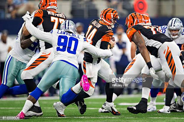 Andy Dalton of the Cincinnati Bengals is hit by and gets away from Demarcus Lawrence of the Dallas Cowboys at ATT Stadium on October 9 2016 in...