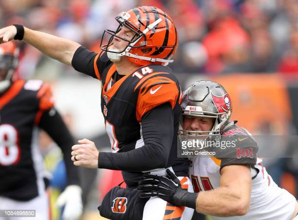 Andy Dalton of the Cincinnati Bengals is hit by Carl Nassib of the Tampa Bay Buccaneers while throwing the ball during the second quarter of the game...