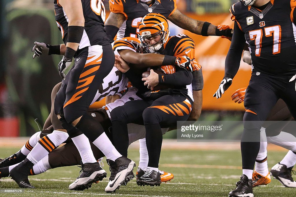 Andy Dalton #14 of the Cincinnati Bengals is sacked by K'Waun Williams #36 of the Cleveland Browns during the third quarter at Paul Brown Stadium on November 6, 2014 in Cincinnati, Ohio.