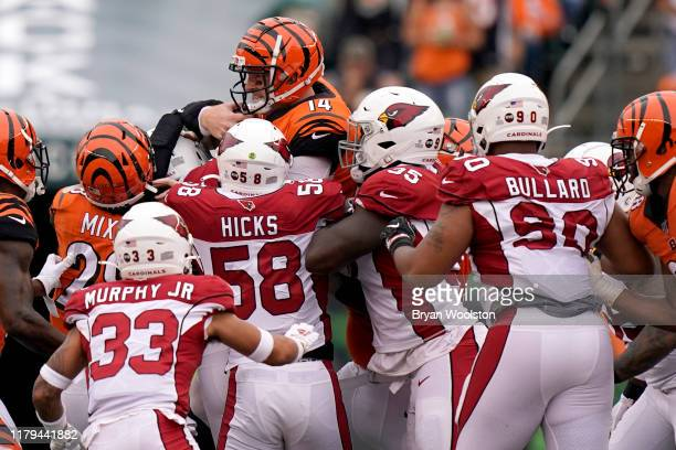 Andy Dalton of the Cincinnati Bengals is stopped at the line of scrimmage for a loss during the NFL football game against the Arizona Cardinals at...