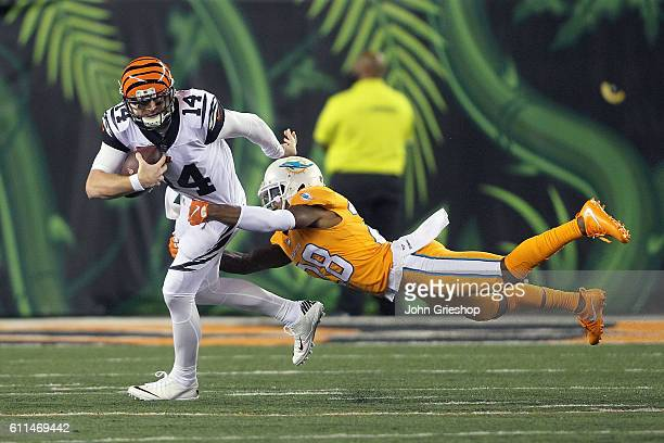 Andy Dalton of the Cincinnati Bengals is tackled by Bobby McCain of the Miami Dolphins during the third quarter at Paul Brown Stadium on September 29...