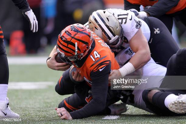 Andy Dalton of the Cincinnati Bengals is tackled by Trey Hendrickson of the New Orleans Saints and Sheldon Rankins during the third quarter at Paul...