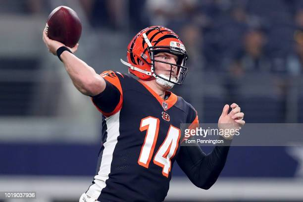 Andy Dalton of the Cincinnati Bengals looks for an open receiver against the Dallas Cowboys in the first quarter at ATT Stadium on August 18 2018 in...