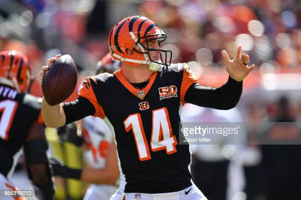 Andy Dalton of the Cincinnati Bengals looks to make a pass in the first quarter against the Cleveland Browns at FirstEnergy Stadium on October 1 2017...