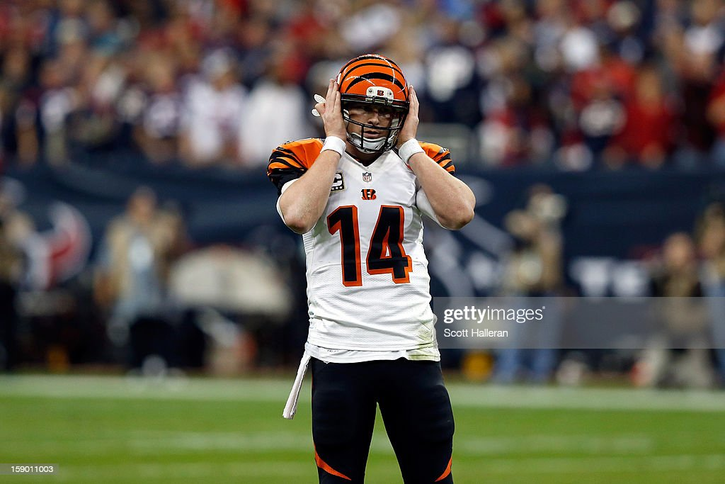 Andy Dalton #14 of the Cincinnati Bengals reacts against the Houston Texans during their AFC Wild Card Playoff Game at Reliant Stadium on January 5, 2013 in Houston, Texas.