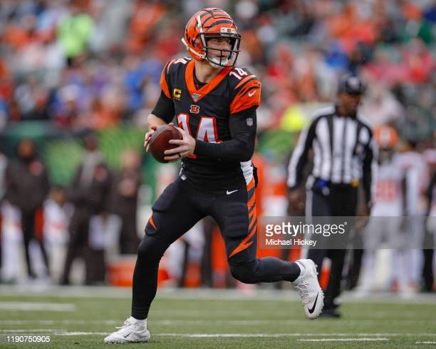 Andy Dalton of the Cincinnati Bengals rolls out of the pocket during the first half against the Cleveland Browns at Paul Brown Stadium on December...