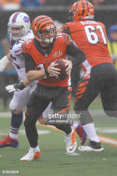 Andy Dalton of the Cincinnati Bengals rolls out to pass during the game against the Buffalo Bills at Paul Brown Stadium on Ocotber 8 2017 in...