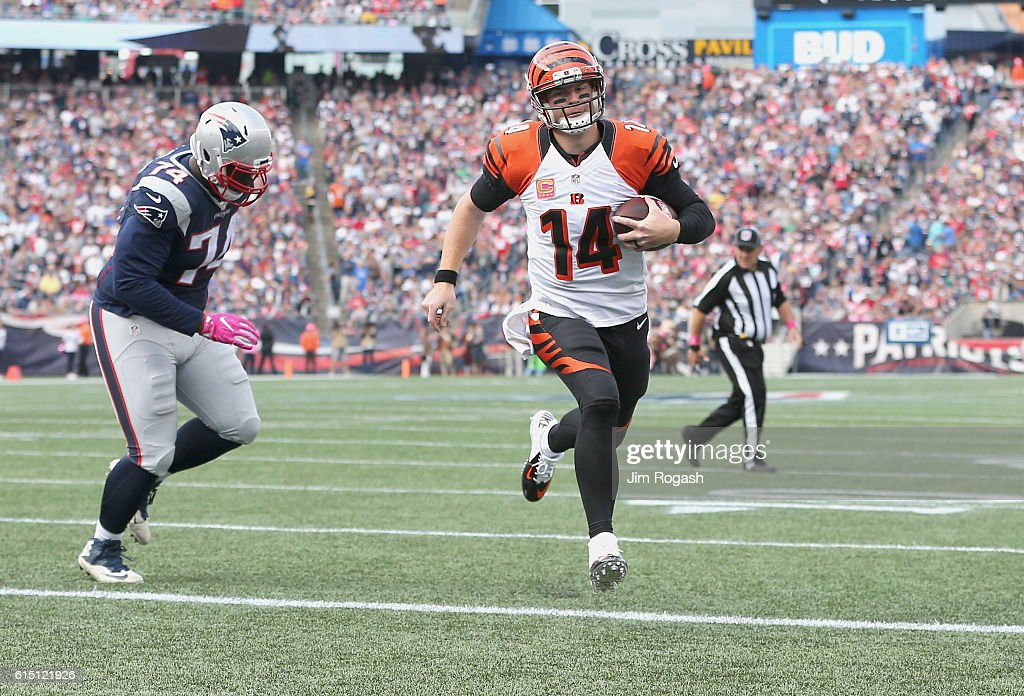 Andy Dalton #14 of the Cincinnati Bengals runs in a touchdown against the New England Patriots during the game at Gillette Stadium on October 16, 2016 in Foxboro, Massachusetts.