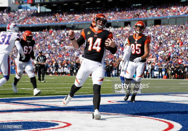 Andy Dalton of the Cincinnati Bengals runs the ball in for a touchdown during the first half against the Buffalo Bills at New Era Field on September...